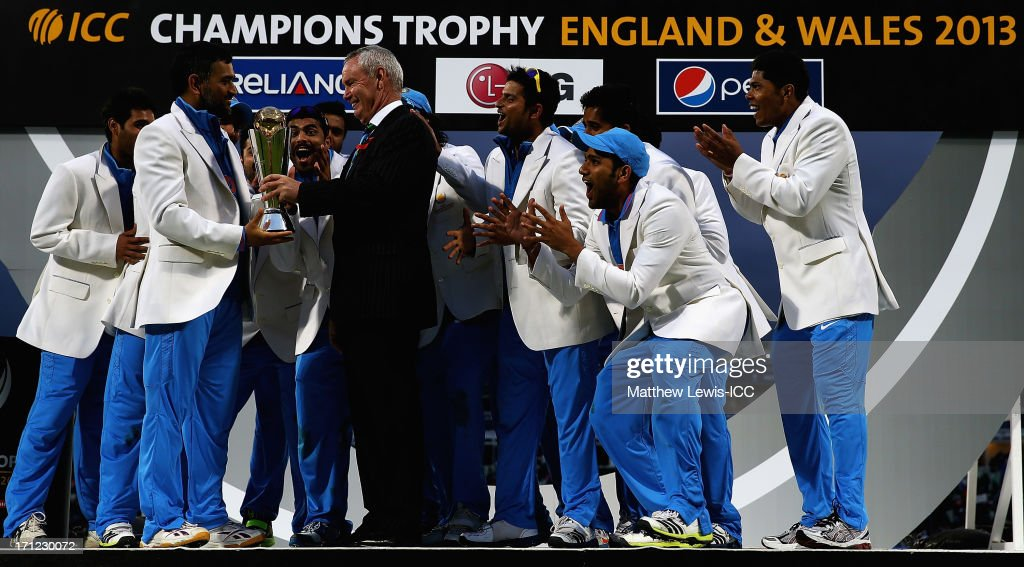 Alan Isaac, President of the ICC presents MS Dhoni, Captain of India with the Champions Trophy, after defeating England in the ICC Champions Trophy Final between England and India at Edgbaston on June 23, 2013 in Birmingham, England.