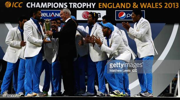 Alan Isaac President of the ICC presents MS Dhoni Captain of India with the Champions Trophy after defeating England in the ICC Champions Trophy...