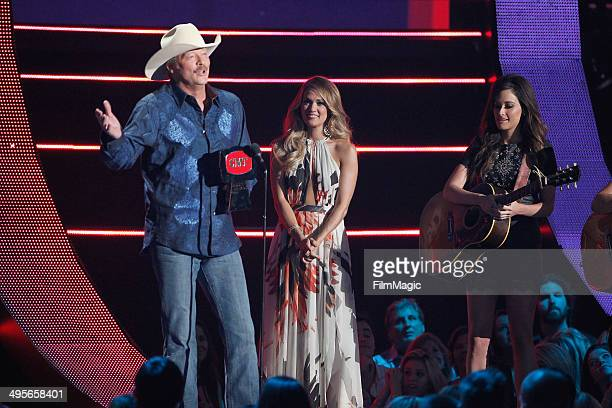 Alan Jackson accepts his award from Carrie Underwood during the 2014 CMT Music awards show at the Bridgestone Arena on June 4 2014 in Nashville...