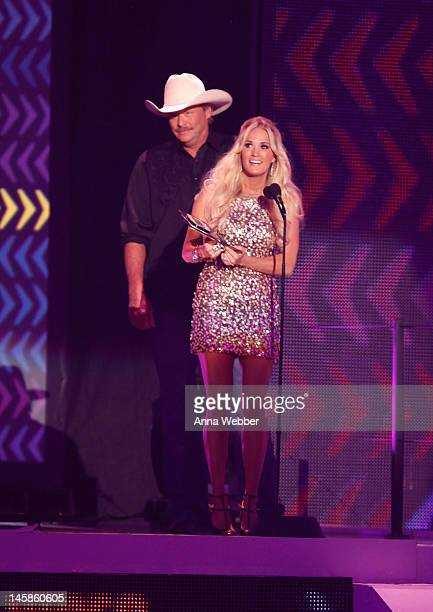 Alan Jackson and Carrie Underwood speak onstage at the 2012 CMT Music awards at the Bridgestone Arena on June 6 2012 in Nashville Tennessee