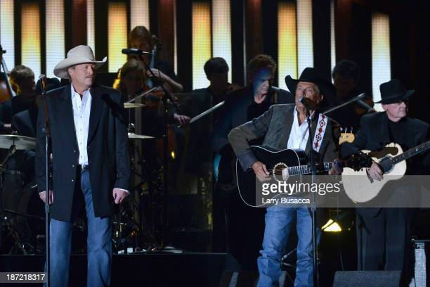 Alan Jackson and Entertainer of the Year award winner George Strait perform onstage during the 47th annual CMA awards at the Bridgestone Arena on...