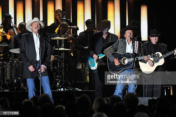 Alan Jackson and George Strait perform a tribute to the late George Jones during the 47th annual CMA awards at the Bridgestone Arena on November 6...