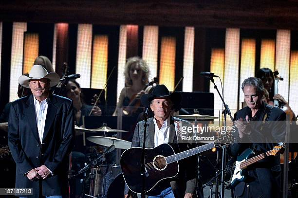 Alan Jackson and George Strait perform onstage during the 47th annual CMA Awards at the Bridgestone Arena on November 6 2013 in Nashville Tennessee
