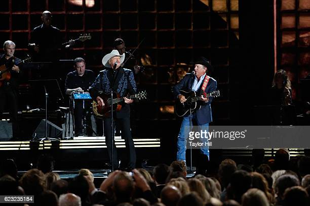 Alan Jackson and George Strait perform onstage during the 50th annual CMA Awards at the Bridgestone Arena on November 2 2016 in Nashville Tennessee
