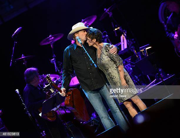 Alan Jackson invites Nancy Jones on stage during Playin' Possum The Final No Show Tribute To George Jones at Bridgestone Arena on November 22 2013 in...
