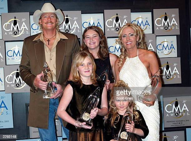 Alan Jackson poses with his 5 awards with a little help from his family wife Denise and Daughters Mattie 12 Ali9 and Dani5 at the 36th annual Country...