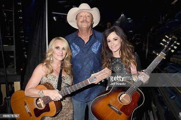 Alan Jackson poses with Lee Ann Womack and Kacey Musgraves perform during the 2014 CMT Music awards at the Bridgestone Arena on June 4 2014 in...