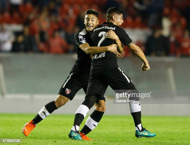Alan Javier Franco of Independiente celebrates with teammate Gaston Togni after scoring the first goal of his team during the first leg match between...