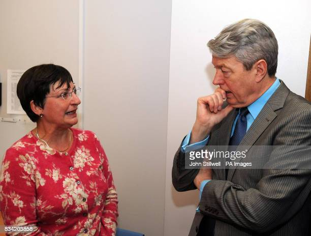 Alan Johnson the Secretary of State for Health talks to Jenny Park who had a cancerous tumor removed 4 years ago during a visit to the breast and...