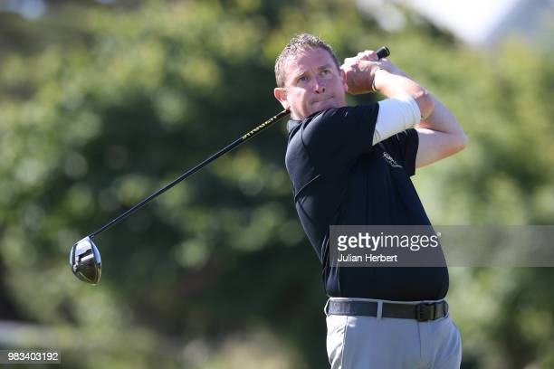 Michael Wilson of Royal North Devon Golf Club looks on as his prtner Mark Lee plays a shot during The Lombard Trophy South West Qualifier at Royal...