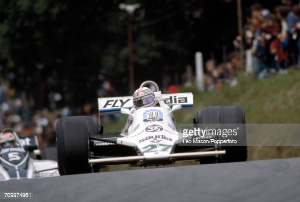 Alan Jones of Australia enroute to a first place finish in the British Grand Prix at Brands Hatch driving a Williams FW07B with a Ford V8 engine for...