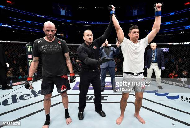 Alan Jouban celebrates after his victory over Ben Saunders in their welterweight bout during the UFC Fight Night event at Amway Center on February 24...