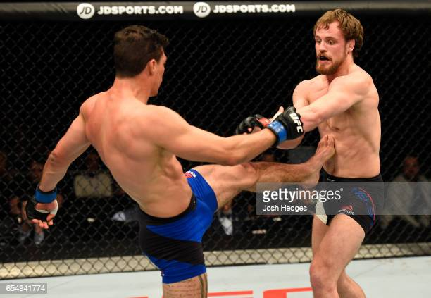 Alan Jouban of the United States kicks Gunnar Nelson of Iceland in their welterweight fight during the UFC Fight Night event at The O2 arena on March...
