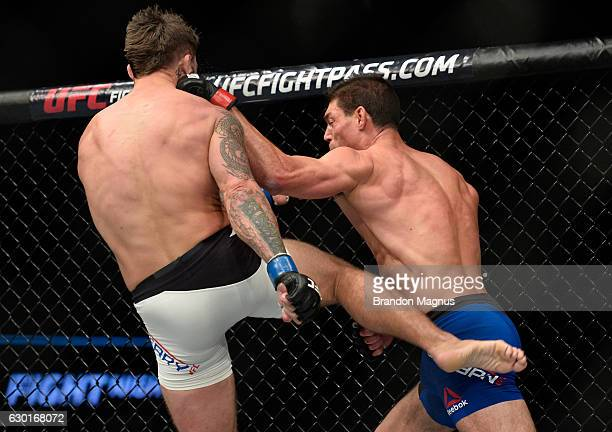 Alan Jouban punches Mike Perry in their welterweight bout during the UFC Fight Night event inside the Golden 1 Center Arena on December 17 2016 in...