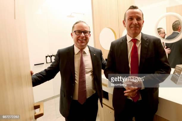 Alan Joyce chief executive officer of Qantas Airways Ltd left and Mark McGowan premier of Western Australia tour the transit lounge during a media...