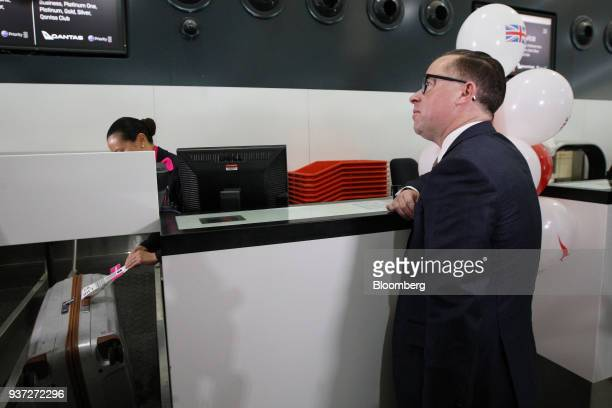 Alan Joyce chief executive officer of Qantas Airways Ltd stands at a checkin counter for the company's inaugural flight to London at Perth Airport...