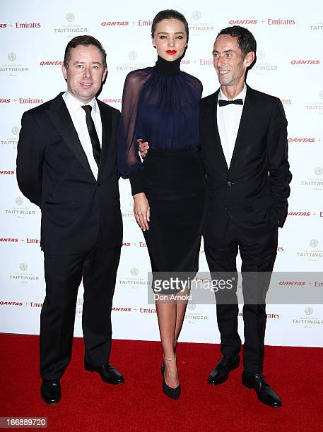 Alan Joyce Miranda Kerr and Martin Grant attend the QANTAS Gala Dinner at Sydney Domestic Airport on April 18 2013 in Sydney Australia