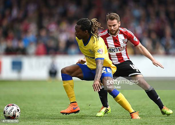 Alan Judge of Brentford and Gaetan Bong of Wigan Athletic in action during the Sky Bet Championship match between Brentford and Wigan Athletic at...