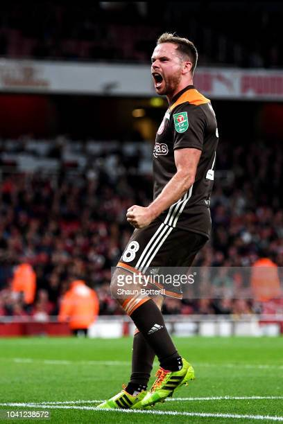 Alan Judge of Brentford celebrates after he scores his sides first goal during the Carabao Cup Third Round match between Arsenal and Brentford at...