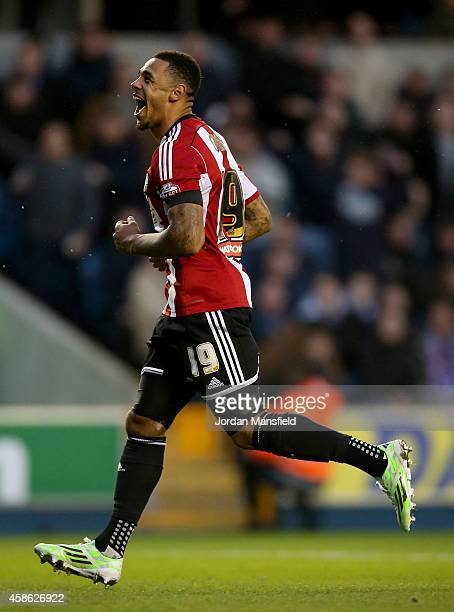Alan Judge of Brentford celebrates after scoring to make it 21 during the Sky Bet Championship match between Millwall and Brentford at The Den on...
