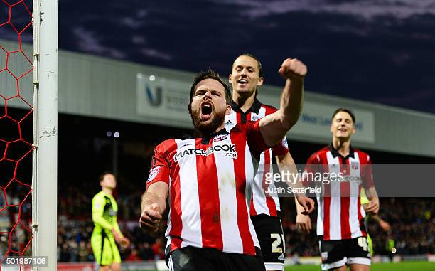 Alan Judge of Brentford celebrates scoring Brentford's 4th goal during the Sky Bet Championship match between Brentford and Huddersfield Town at...