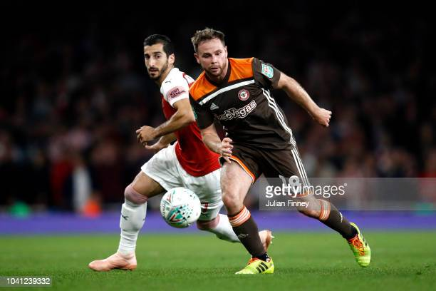 Alan Judge of Brentford is challenged by Henrikh Mkhitaryan of Arsenal during the Carabao Cup Third Round match between Arsenal and Brentford at...