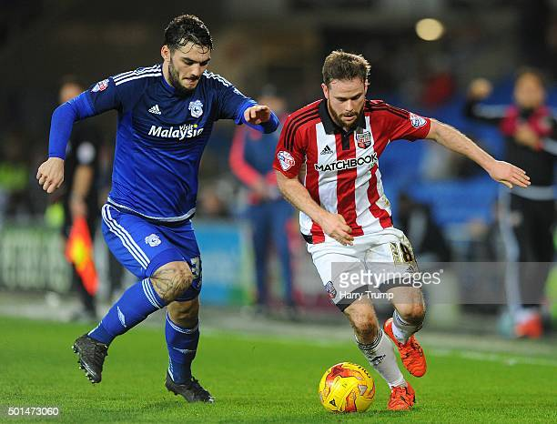 Alan Judge of Brentford is tackled by Tony Watt of Cardiff City during the Sky Bet Championship match between Cardiff City and Brentford at the...