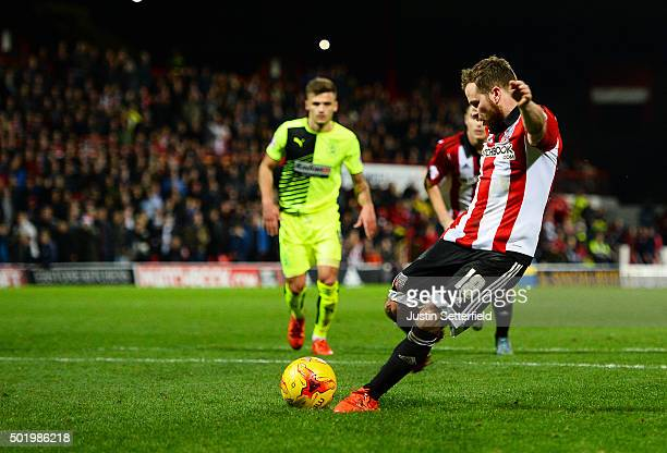 Alan Judge of Brentford scores Brentford's 4th goal during the Sky Bet Championship match between Brentford and Huddersfield Town at Griffin Park on...