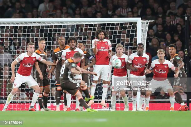 Alan Judge of Brentford sends a freekick over the Arsenal wall to score the first and only Brentford goal during the Carabao Cup Third Round match...