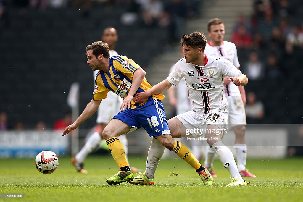 Alan Judge of Brentford tackles with Giorgio Rasulo of MK Dons during the Sky Bet League One match between MK Dons and Brentford at Stadium mk on April 21, 2014 in Milton Keynes, England.