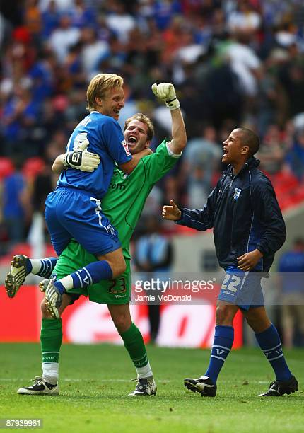 Alan Julian of Gillingham celebrates victory with Josh Wright and Albert Jarrett following the Coca Cola League 2 Playoff Final match between...