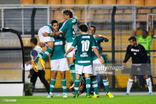 Alan Kardec of Palmeiras celebrates a scored goal during the match between Palmeiras and Bragantino for the Brazilian Championship Serie B 2013 at...