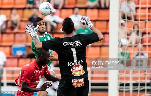 Alan Kardec of Palmeiras fights for the ball with Rodrigo Souza and goalkeeper Douglas of Boa Esporte during the match between Palmeiras and Boa...