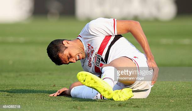 Alan Kardec of Sao Paulo is injured during the match between Sao Paulo and Santos for the Brazilian Series A 2014 at Estadio do Morumbi on August 24...
