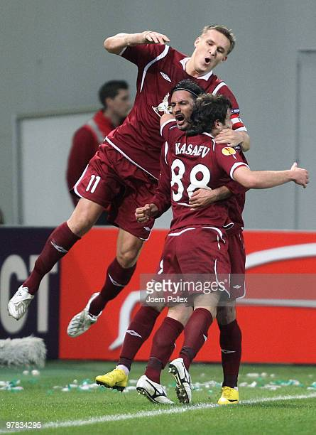 Alan Kasaev of Kazan celebrates with his team mates after scoring his team's first goal of Kazan compete for the ball during the UEFA Europa League...