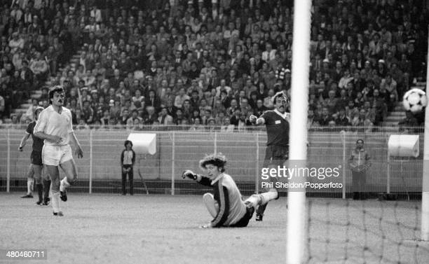 Alan Kennedy of Liverpool watches as his shot goes past Real Madrid goalkeeper Augustin Rodriguez for the winning goal in the European Cup Final at...