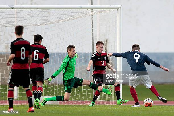 Alan Kerouedan of France challenges Christian Fruchtl and Jan Wellers of Germany and scores during the UEFA Under16 match between U16 France v U16...