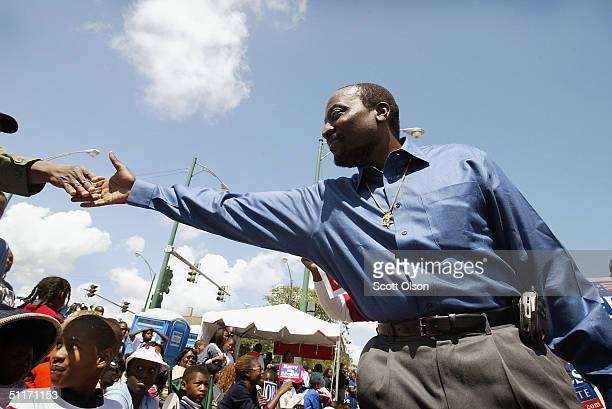 Alan Keyes Republican candidate for US Senate from Illinois campaigns during the Bud Billiken parade August 14 2004 on the South Side of Chicago...