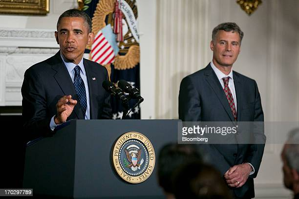 Alan Krueger chairman of the Council of Economic Advisers right listens as US President Barack Obama speaks during a nomination announcement in the...