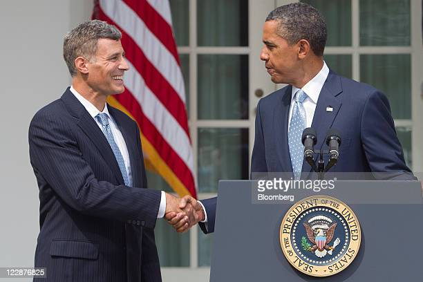 Alan Krueger nominee to lead the White House Council of Economic Advisers left shakes hands with US President Barack Obama after announcing his...