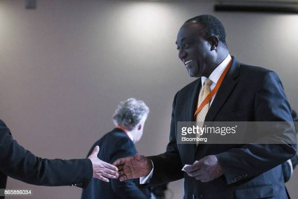 Alan Kyerematen Ghana's former minister of trade right shakes hands with an attendee during the Mexico Business Summit in San Luis Potosi Mexico on...