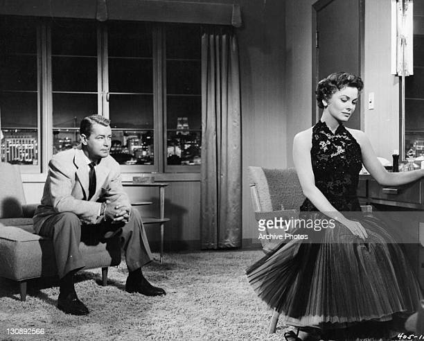 Alan Ladd asks Joanne Dru to leave town because he believes her life may be in danger in a scene from the film 'Hell On Frisco Bay' 1955