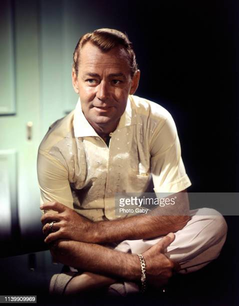 Alan Ladd in his home in Palm Springs, California, May 1958.