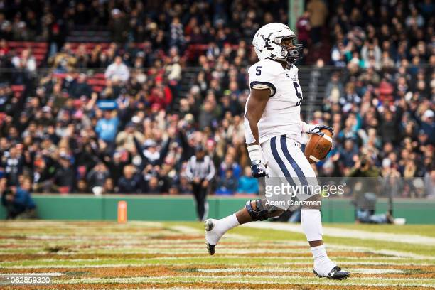 Alan Lamar of the Yale Bulldogs scores a touchdown during a game against the Harvard Crimson at Fenway Park on November 17 2018 in Boston...