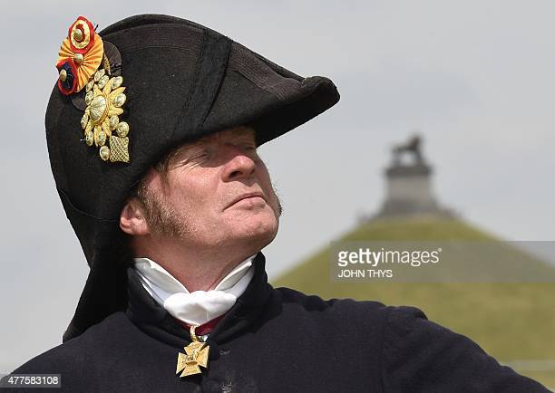 Alan Larsen a historical events consultant from New Zealand playing the role of The Duke of Wellington poses in front of Lion's Mound during the...