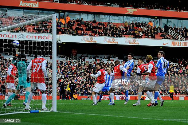 Alan Lee of Huddersfield heads the goal that levels the scores at 11 past goalkeeper Manuel Almunia of Arsenal during the FA Cup sponsored by EON...