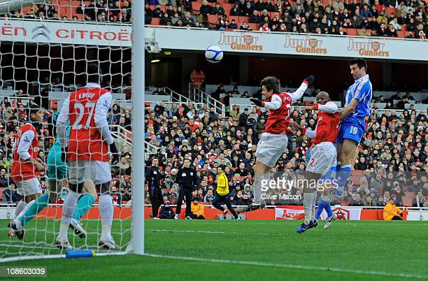 Alan Lee of Huddersfield rises above the arsenal defence to head the goal that levels the scores at 11 during the FA Cup sponsored by EON fourth...