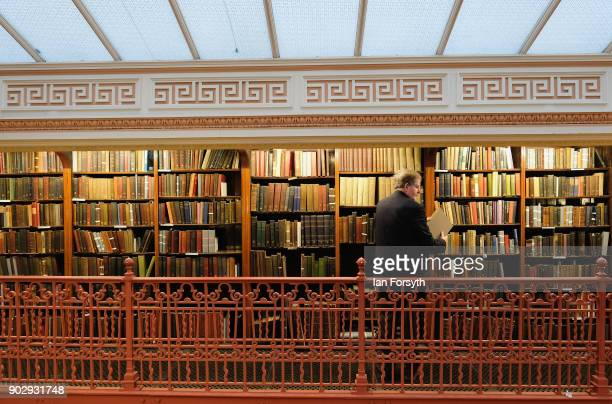 Alan Longbottom a library member for 30 years browses the books inside the New Room at the Leeds Library on January 9 2018 in Leeds England This year...