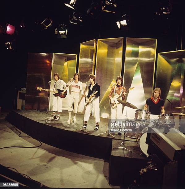 Alan Longmuir Les McKeown Eric Faulkner Stuart Wood and Derek Longmuir of the Bay City Rollers perform on the BBC television show 'Top of the Pops'...