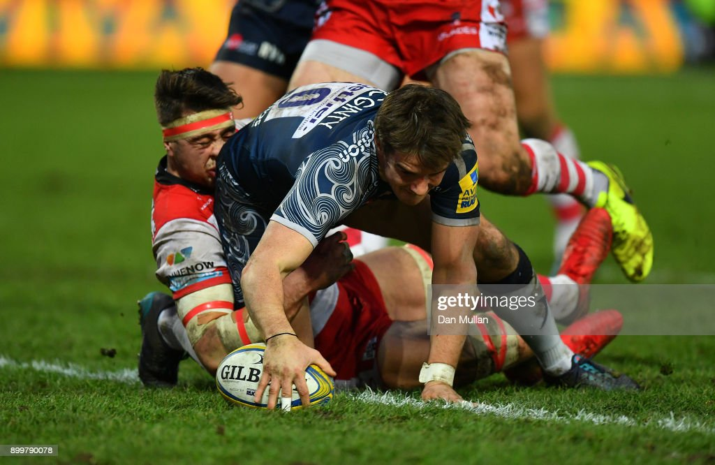 Alan MacGinty of Sale Sharks dives over to score his sides first try during the Aviva Premiership match between Gloucester Rugby and Sale Sharks Sharks at Kingsholm Stadium on December 30, 2017 in Gloucester, England.